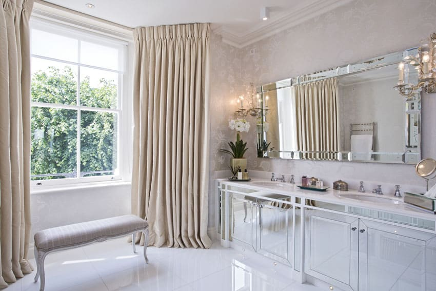 Modern bathroom with silver mirrored vanity cabinet