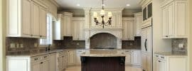 u-shaped-kitchen-with-antique-white-cabinets