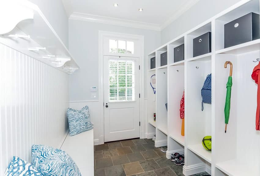 Bright white mudroom with built in cubbie storage