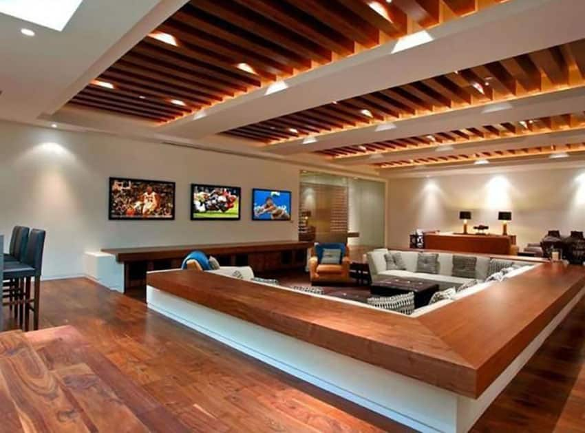 Contemporary sunken living room with wood floors and exposed beams
