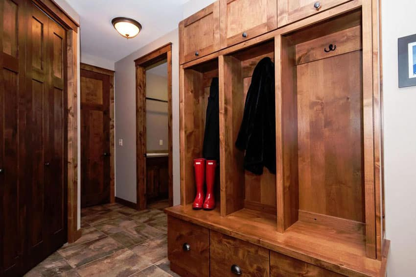 Craftsman style wood mud room with rustic storage cabinet