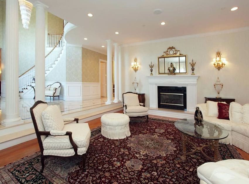 Formal traditional sunken living room with decorative pillars
