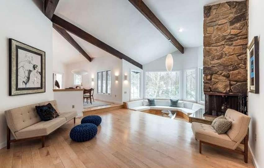 Living room with sunken sitting area and wood beam ceiling