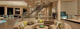luxury-sunken-living-room-with-wood-flooring-and-high-ceilings