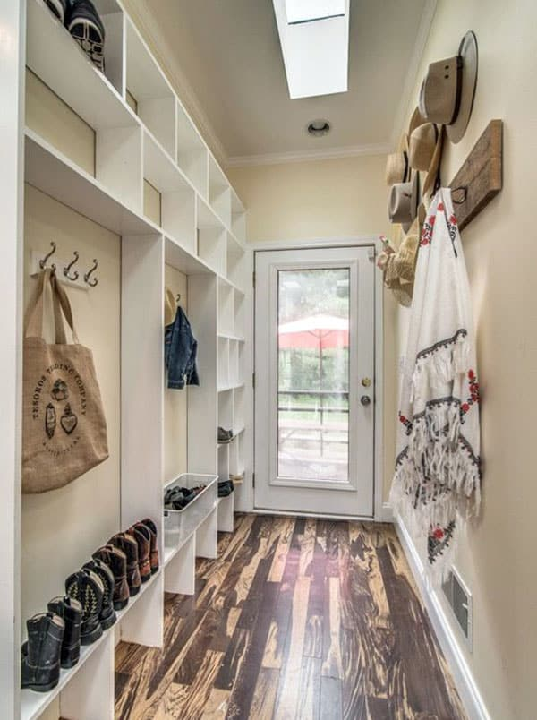 Mud room with cubbie storage and skylight