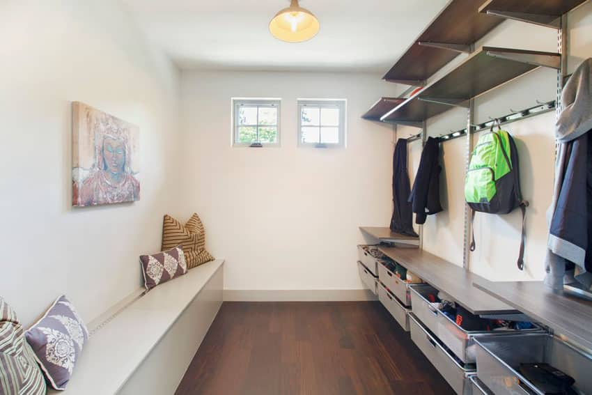 Mud room with organizer cubbies shelving and coat racks