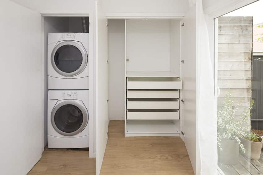 Small laundry mudroom with shelving unit
