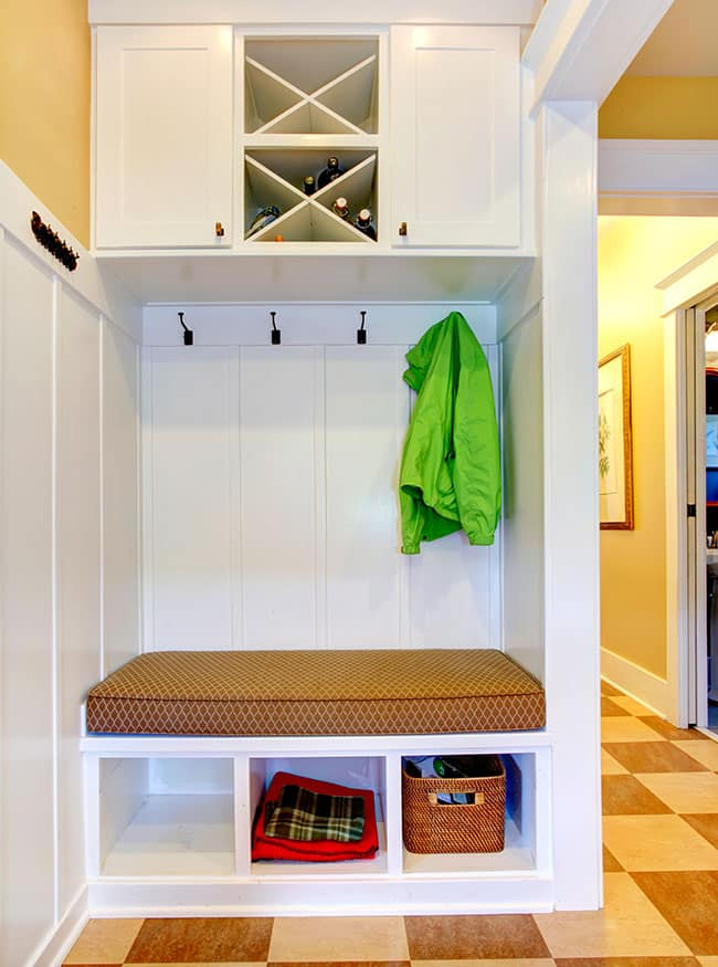 Tall mudroom cabinet with cushioned bench and above and under seat storage