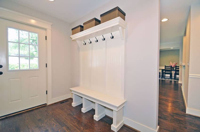 Traditional entryway mudroom with small bench and overhead storage