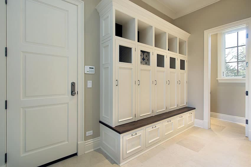 White cabinet mudroom with storage lockers and cubbies