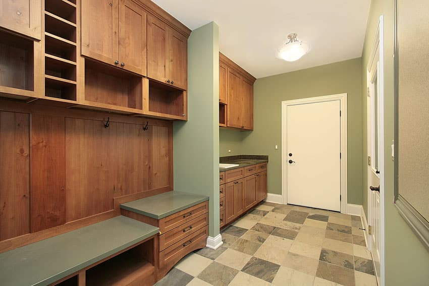 Garage entry mudroom with built-in wood cabinet
