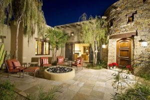 mediterranean-style-patio-with-round-stucco-fire-pit-17