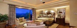 tan-luxury-master-bedroom-with-wood-floors-and-outdoor-balcony