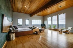contemporary-master-bedroom-with-oak-wood-floors-and-ceiling
