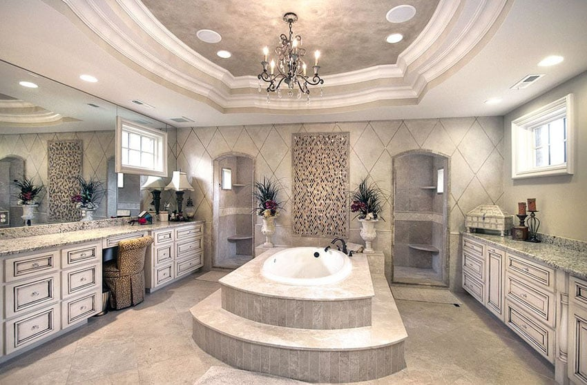 Expansive master bathroom with central enclosed tub with roman style faucet