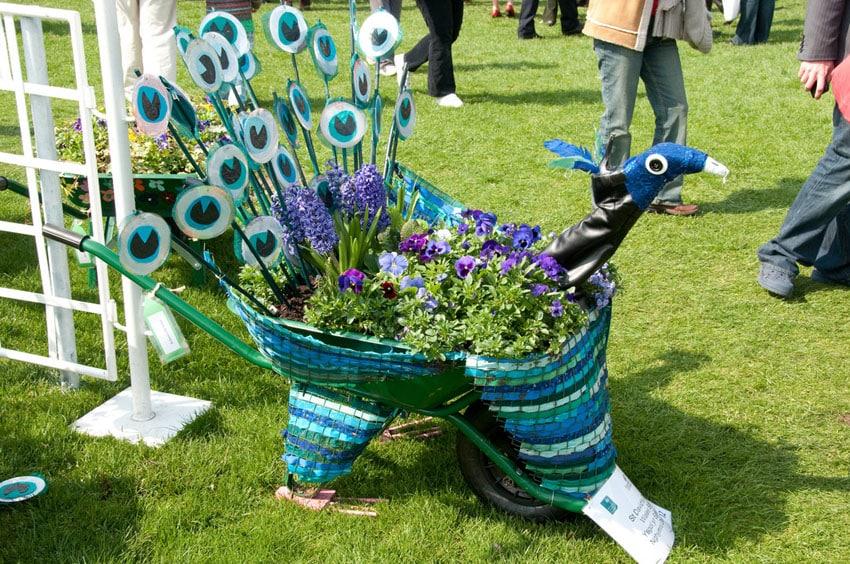 Decorative wheelbarrow planter with bird design