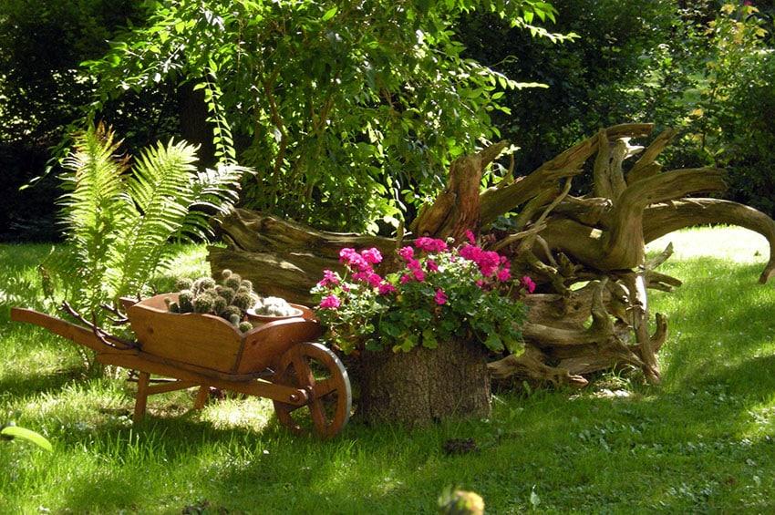 Decorative flower garden with small wood wheelbarrow
