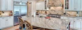 luxury-kitchen-with-island-and-lennon-granite-slab-countertop