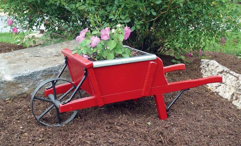 Old fashioned wheelbarrow planter