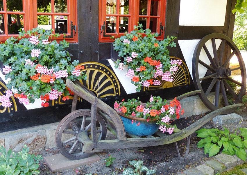Wheelbarrow cart with flower pot