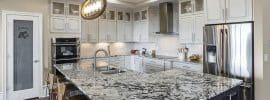 white-kitchen-with-blizzard-granite-countertop