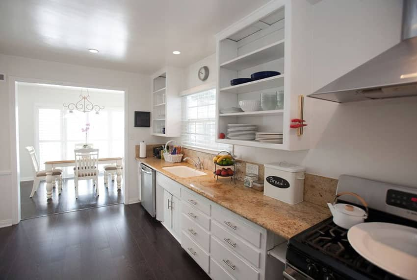 Small one wall cottage kitchen with open shelving and white base cabinets