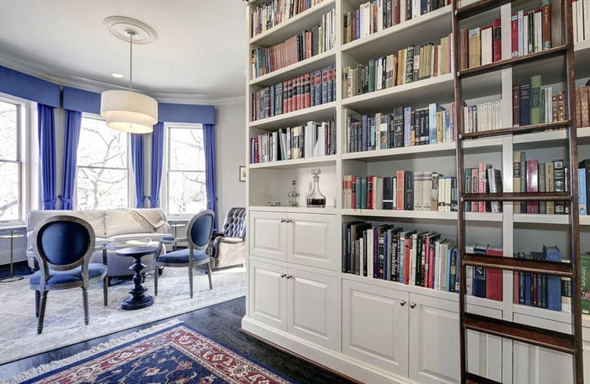 Traditional Library With Built In Bookshelf And Attached Living Room