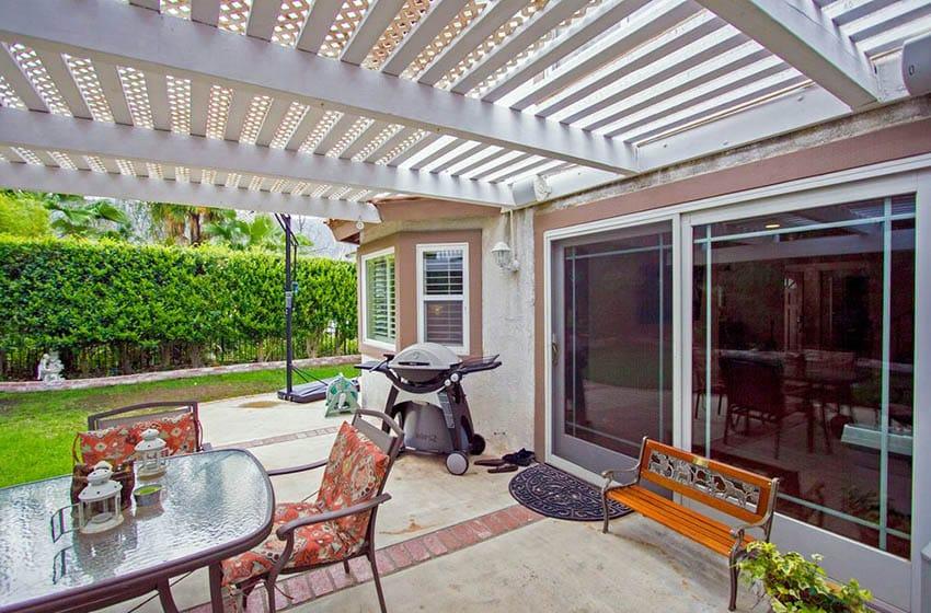 Backyard pergola with white lattice canopy