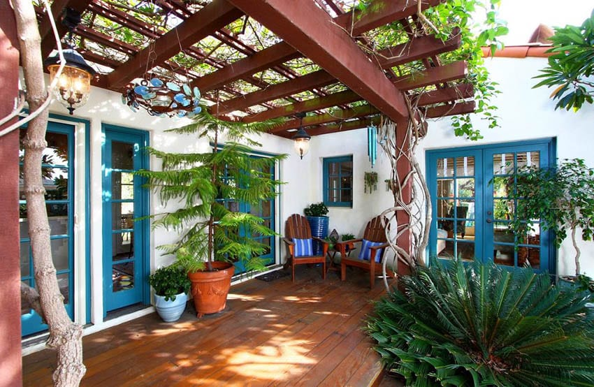 Mediterranean patio deck with covered garden pergola