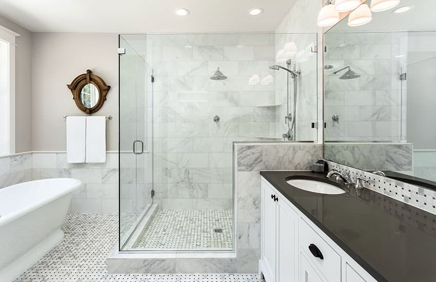 White bathroom with frameless door shower with clear glass