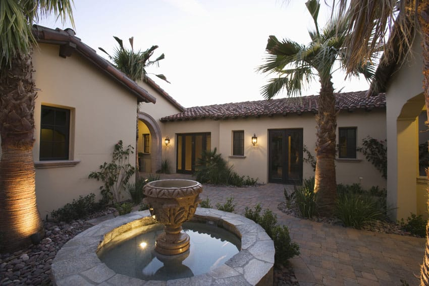 Rustic patio fountain in spanish style courtyard