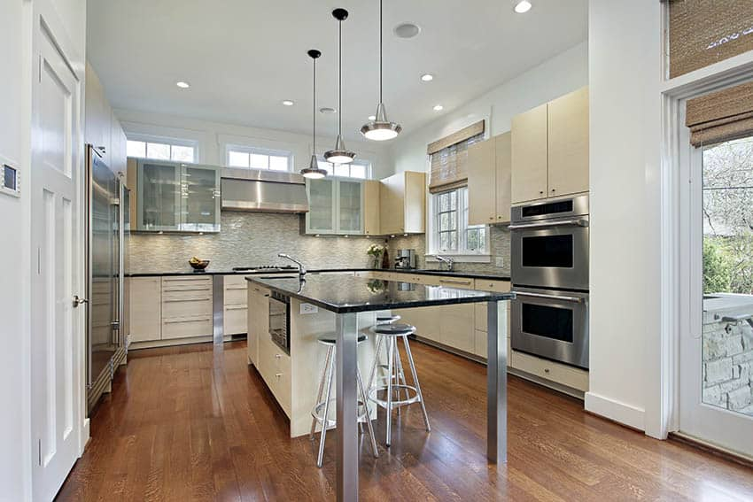 contemporary-u-shaped-kitchen-with-cream-color-cabinets-and-black-granite-island