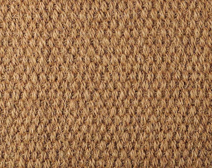 Coir carpet fibers in close up of rug
