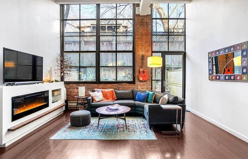 Stylish loft living room with dark stained bamboo flooring