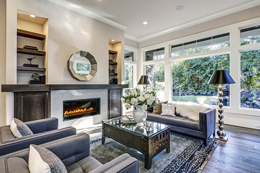 Contemporary living room with gas fireplace long wood mantel wood flooring built in shelving