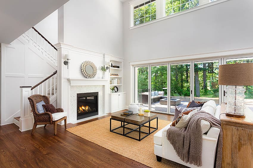 Contemporary living room with large center area rug over wood flooring
