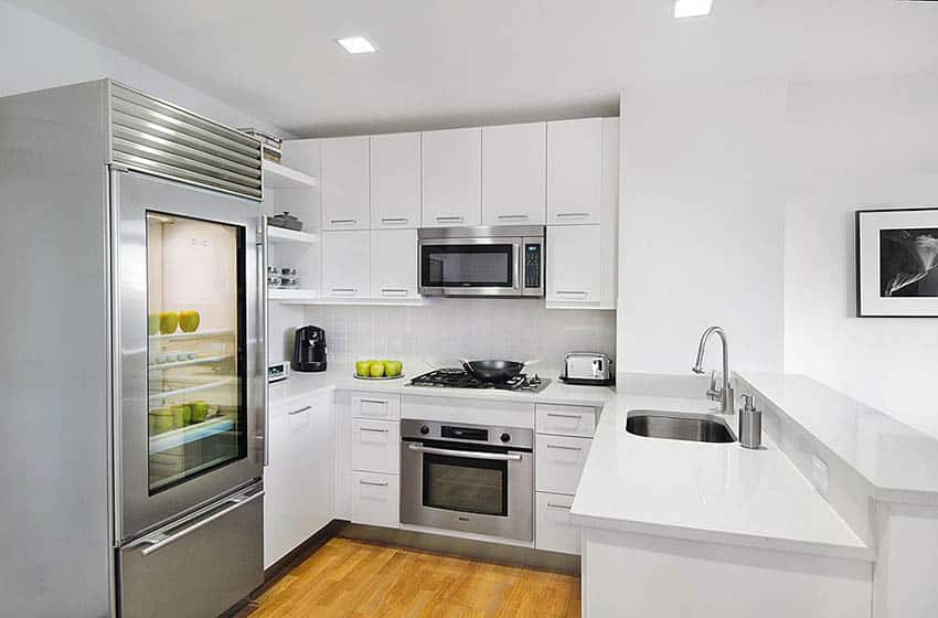 Contemporary u shaped kitchen with peninsula white cabinets and bianco antico granite countertops