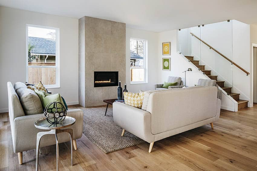 Living room with mid century modern lawson sofa tile fireplace
