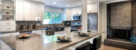 modern-kitchen-with-cork-plank-floors-and-white-cabinets