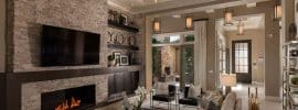 traditional-living-room-with-shades-of-brown-stone-fireplace-and-high-ceilings