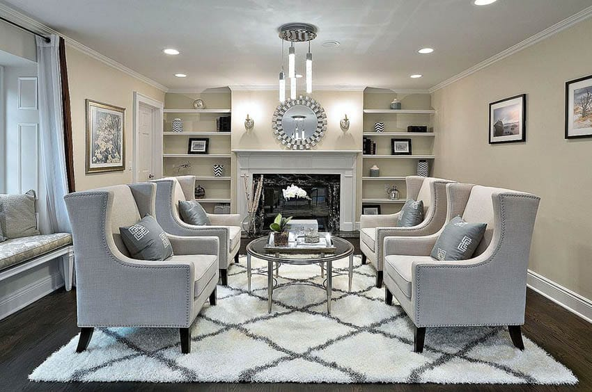 Formal living room with dark wood flooring fireplace and wing chairs