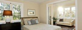 master-bedroom-with-sliding-pocket-door-and-chandelier