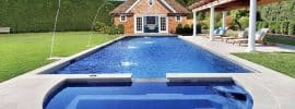 rectangular-swimming-pool-with-semi-circle-hot-tub-and-water-fountains