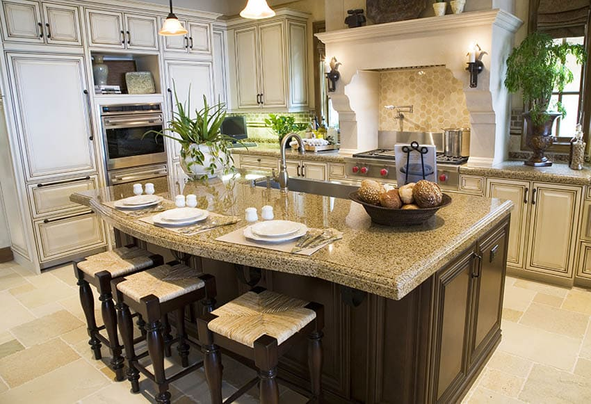 Traditional kitchen with beige granite and distressed cream cabinets