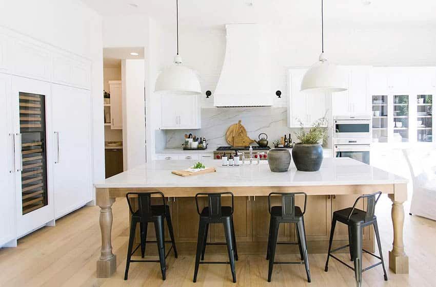 Chefs kitchen with marble and quartz countertops white cabinets luxury appliances