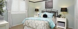 teen-girls-bedroom-with-white-furniture-light-blue-walls