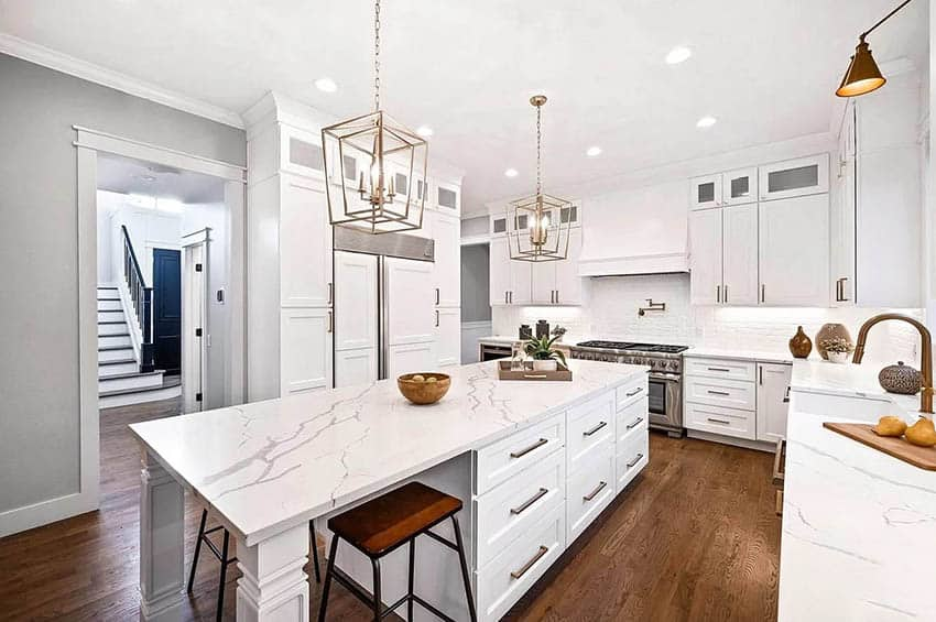 Beautiful kitchen with calacatta nuvo quartz countertops white shaker cabinets gold hardware finishes