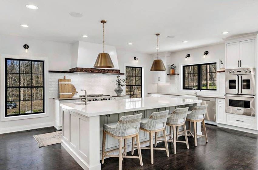 Beautiful l shaped kitchen with island white cabinets counter and backsplash