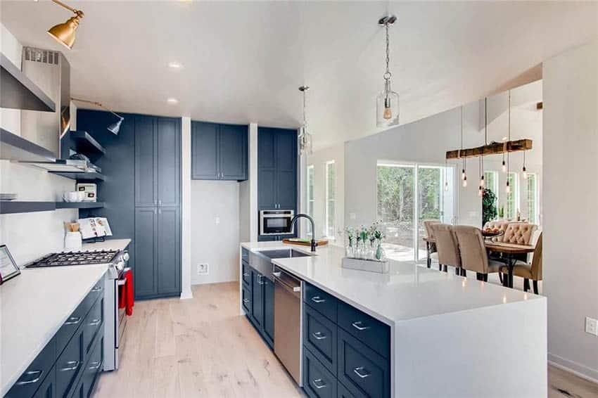 Contemporary blue cabinet kitchen with white quartz countertops