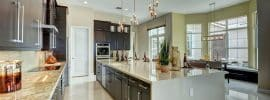 contemporary-kitchen-with-calacatta-gold-marble-floors-and-dark-cabinets